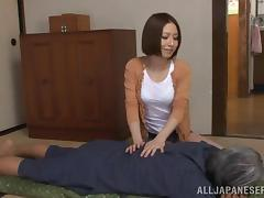 A sexy Asian therapist in thong enticing a client erotically