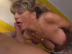 Pigtailed granny in white fishnets is happy to take young cock inside