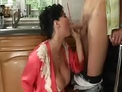 Big titted housewife takes a younger cock