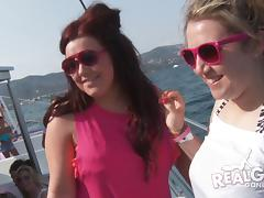 Slutty party girls on a boat dancing and flashing tits