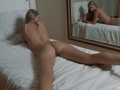 Blonde Lexi Bloom puts a hand down her panties and rubs her clit