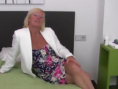 Blonde cougar is still very good in her regular masturbation sessions