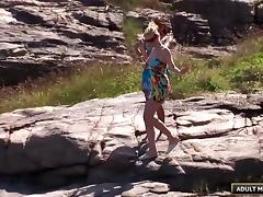 Blonde babe at the beach fucked by two guys outdoors