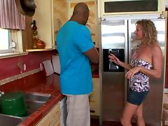 Experienced curly-haired chick banged by the black guy in the kitchen
