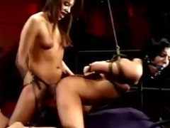 Dominatrix fucks girl with a strapon
