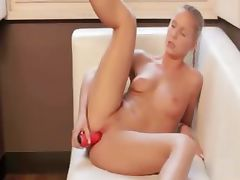 Red sexy toy in her charming snatch