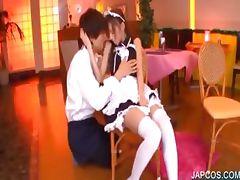 Asian maiden sensually kissing a guy