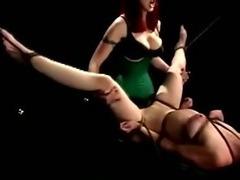 Dominatrix slaps and violates a slaves swollen pussy