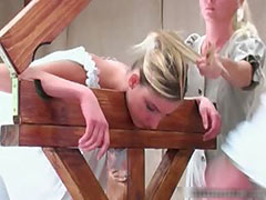 Cute blonde caned in a guillotine