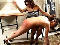 Dominant Ebony Babe Spanks Kinky Lesbian's Ass With a Bondage Paddle