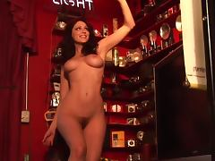 Luscious Carlotta Champagne poses naked on the bar
