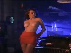 Charming hottie Wendy Hamilton poses for the cam near a car