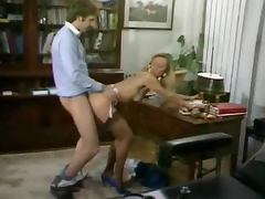 Retro video with a blonde hottie getting fucked in an office