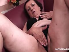 Mature horny slut rubbing her pussy and hot nipples