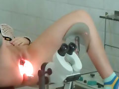Amateur doctor shows off her shaved pussy on the hidden cam