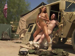 Brunette with pigtails fucks with a military guy