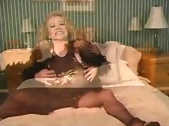 Busty mature plays with a huge dildo