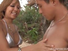 Nana Aotama big boobed milf enjoys beach sex