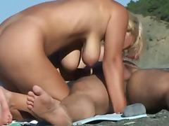 Blond wife engulfing husbands schlong at the beach