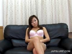 Asian slut stripping on the couch